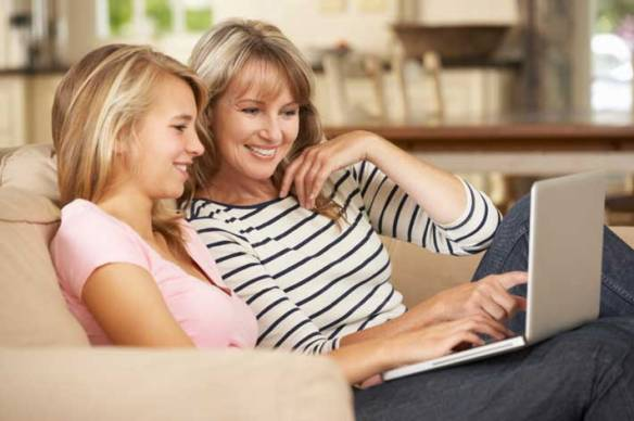 adolescence-mother-daughter-at-computer-710x472